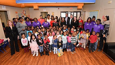 First Lady Yumi Hogan joined the Anne Arundel County Food Bank in distributing holiday gifts to children and families at ...