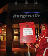 Edith Gillis pickets in front of the Hawthorne Burgerville days after it won federal recognition as a unionized shop.