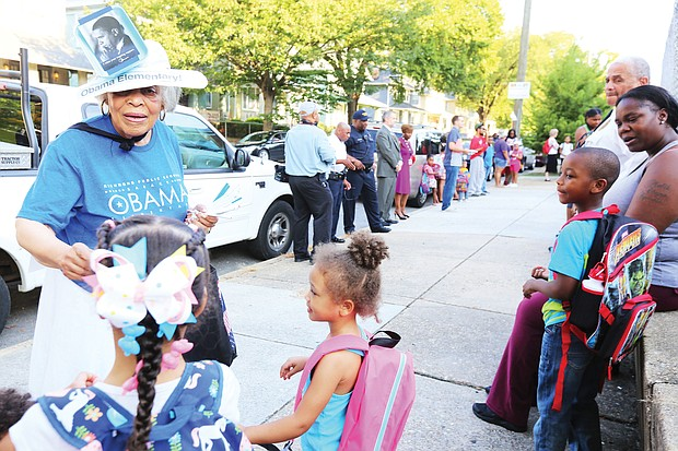 Ruth R. Little, a retired teacher, greets students on their first day of classes at the newly named Obama Elementary School on Fendall Avenue in North Side in September.
