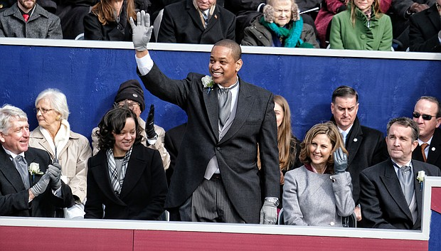 Lt. Gov. Justin E. Fairfax waves to a cheering crowd after taking the oath of office in January. He is only the second African-American to be elected to statewide office in Virginia. His wife, Dr. Cerina Fairfax, a dentist, is seated next to him with Attorney General Mark Herring and First Lady Pam Northam and Gov. Ralph S. Northam, right.
