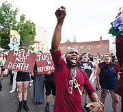 Hip-hop musician J. Roddy Rod joins a crowd of more than 300 people at a June rally and march protesting the shooting death of Marcus-David Peters, 24, by a Richmond Police officer.
