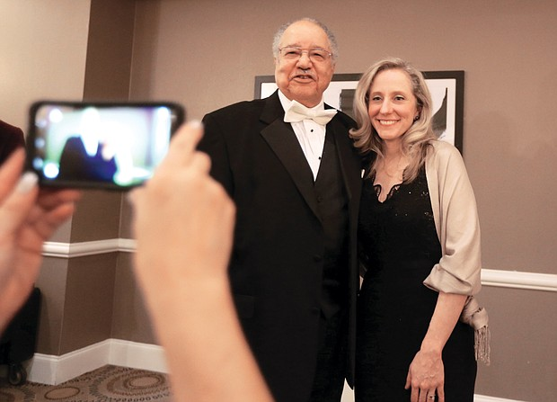 """Dr. Clinton V. Turner, former Virginia secretary of agriculture and consumer services, poses for a photograph with Congresswoman-elect Abigail Spanberger of Henrico County during the reception at the Richmond Continentals' """"Elegance in Black & White"""" fundraising gala."""