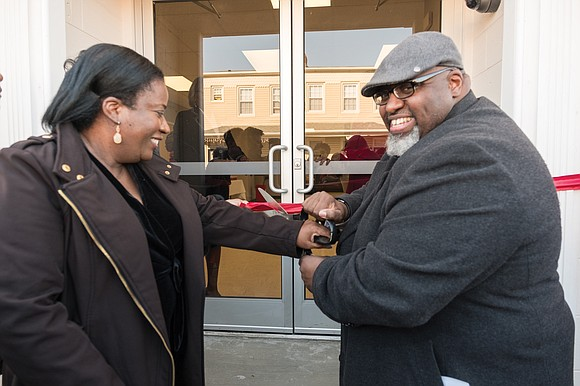 Yvette Glasgow Keesee of Greenwood Village, Colo., and the Rev. William E. Jackson Sr., pastor-elect of Fourth Baptist Church, cut ...