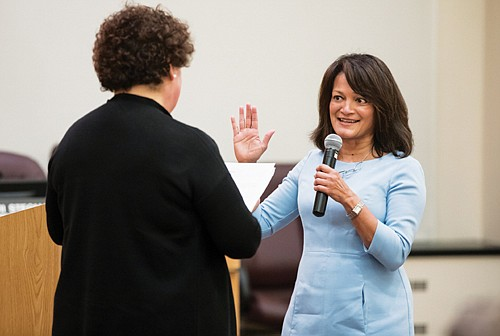 Multnomah County on Thursday swore in Susheela Jayapal as the Board of Commissioners' first Indian-American member. She succeeds Loretta Smith who was prevented by term limits for running for re-election and then lost an elect ion for Portland City Council.