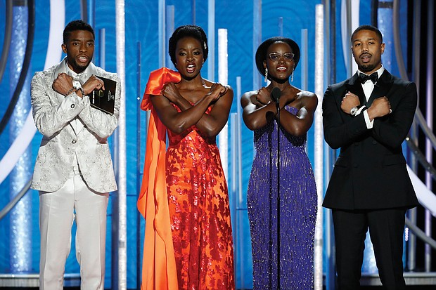 """Golden Globe Award presenters, from left, Chadwick Boseman, Danai Gurira, Lupita Nyoung'o and Michael B. Jordan give the """"Wakanda salute"""" from their box office hit """"Black Panther"""" during the Sunday ceremony. The film and several of the actors were nominated for awards, but went home empty-handed."""
