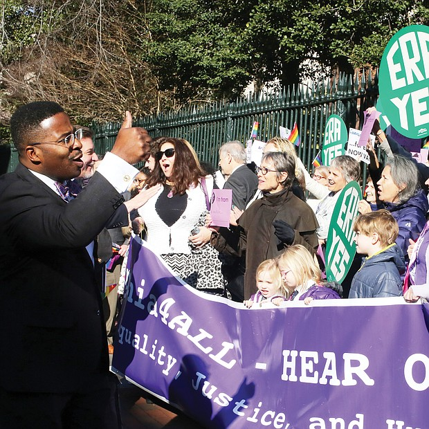 "New year, new session: Chesapeake Delegate C.E. ""Cliff"" Hayes Jr. gives a thumbs-up Wednesday to advocates in Capitol Square urging the legislature to pass the Equal Rights Amendment to give equal status to women under the U.S. Constitution. (Regina H. Boone/Richmond Free Press)"