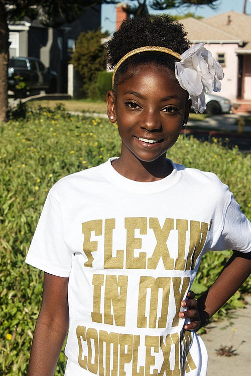 12-Year Old Kheris Rogers poses in her Flexin' In My Complexion T-Shirt