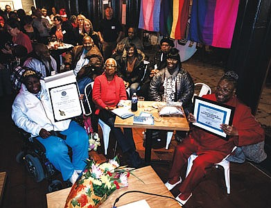 Residents from J. Van Story Branch, Sr. Housing Apartment complex received a certificate of recognition from Central Baltimore Partnership