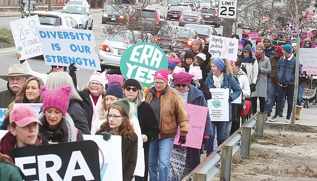 Hundreds of participants calling for equal rights walk the 2-mile loop from the Arthur Ashe Jr. Athletic Center on the Boulevard to Broad Street during last Saturday's Women's March RVA.