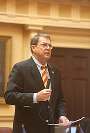Lt. Gov. Justin E. Fairfax takes a seat in the Senate chamber last Friday rather than preside at the dais when Republican state Sen. Richard H. Stuart of King George County, above, asks that the body adjourn for the day in honor of Confederate Gen. Robert E. Lee.