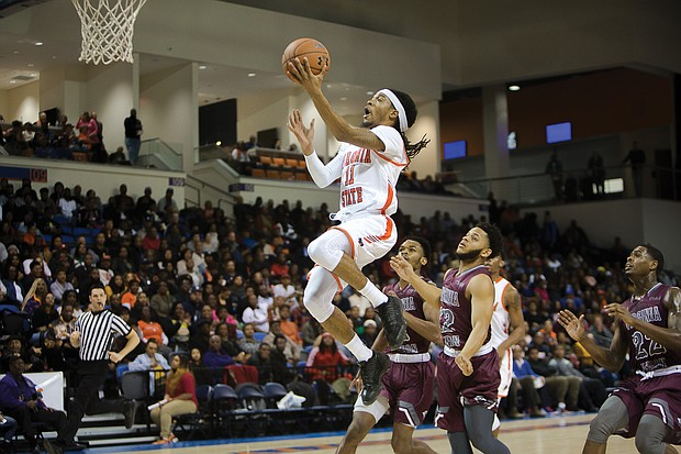 Virginia State University's Cyonte Melvin goes airborne to the rim during last Saturday's Freedom Classic at the VSU Multi-Purpose Center.