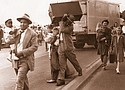 People carry what they can during an evacuation of Vanport as floodwaters pour into the town just north of Portland from a broken railroad levy on May 30, 1948. Soon the entire town would be washed away. The Vanport Mosaic project shares oral histories of life in Portland during the time and other struggles with race over the course of Portland's history.