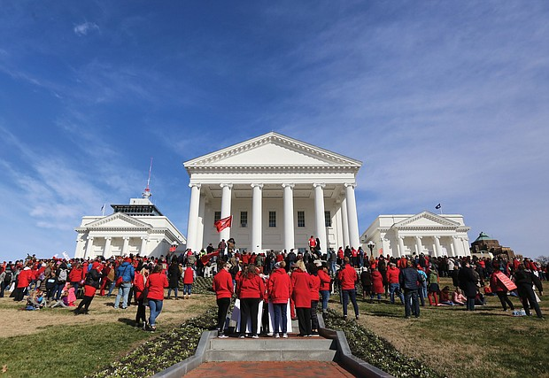 Thousands of teachers, parents, students, administrators, elected officials and education supporters gather Monday at the State Capitol after a march from Monroe Park to demand more money for public education in Virginia. The event was part of Virginia Educators United's #RedforEd campaign.