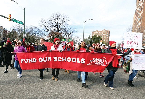 Marching for education: People of all ages wearing red hats, scarves, jackets and shirts signal their support for more state money for public education in Virginia during Monday's #RedforEd march and rally from Monroe Park to the State Capitol. State lawmakers meeting at the General Assembly session said they will support a 5 percent pay hike for Virginia's teachers. (Regina H. Boone/Richmond Free Press)