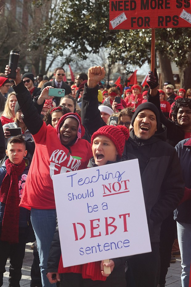 Among the educators in the throngs of people are Richmond Public Schools' Keri Treadway, holding the sign, and Ram Bhagat, right.