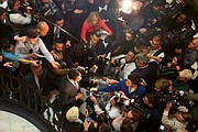 Lt. Gov. Justin E. Fairfax, center, is swarmed by reporters Monday inside the Capitol Rotunda as he responds to an allegation that he sexually assaulted a woman in 2004. He has denied the allegation.