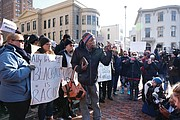 Protesters gather outside the Executive Mansion on Saturday morning demanding the resignation of Gov. Ralph S. Northam.