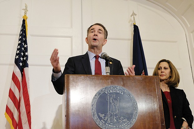 Gov. Ralph S. Northam backpedals during a news conference at the Executive Mansion on Saturday, saying that he is not either of the two people in the racist photo that was published on his 1984 Eastern Virginia Medical School yearbook page. Standing by his side is his wife, First Lady Pam Northam.