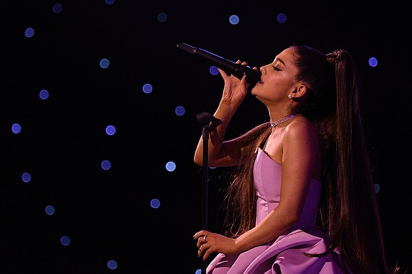 One, two, three -- Ariana Grande is in the best possible place to be.