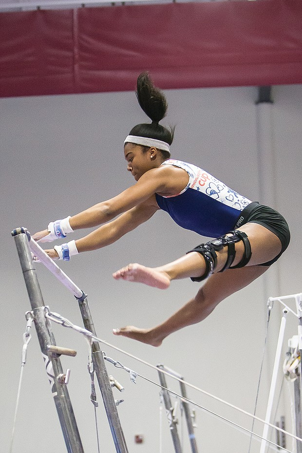 Left, Chesterfield County athlete Elexis 'Lexi' Edwards shows her gymnastic skills on the uneven bars.