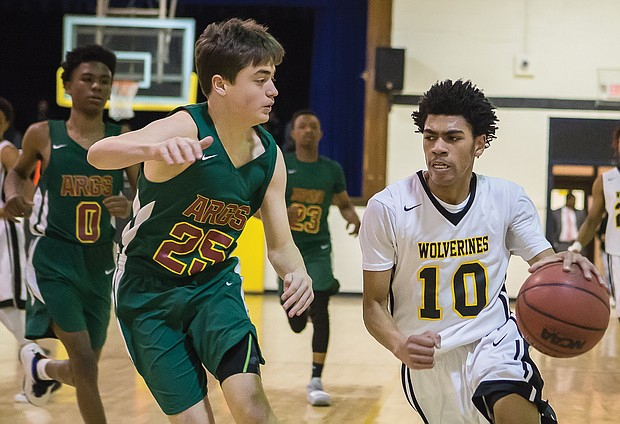 "Carver Academy's Mikael ""Mick"" Jaaber goes in for a basket during Monday's regional playoff game against Appomattox Regional Governor's School."