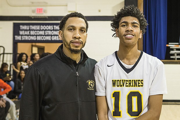 Mikael Jaaber smiles with his dad, former Virginia Union University basketball standout, Luqman Jaaber, who is an assistant coach for Carver Academy's varsity team.