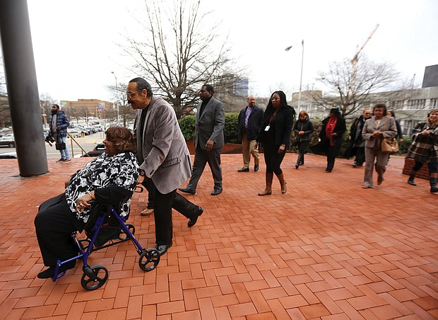 Honoring the Richmond 34- Later last Friday, Richmond 34 members head to the John Marshall Courts Building in Downtown, right, where several members had their arrest records from 59 years ago expunged in a hearing before Chief Judge Joi Jeter Taylor in Richmond Circuit Court. (Regina H. Boone/Richmond Free Press)