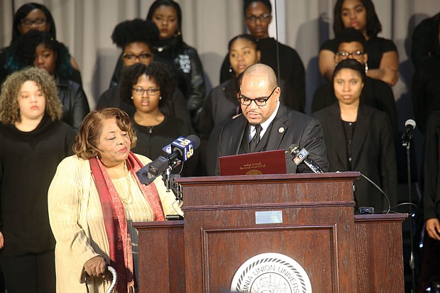 Honoring the Richmond 34- Elizabeth Johnson Rice listens as Virginia Union University President Hakim J. Lucas reads a proclamation honoring Ms. Johnson Rice and the 33 other VUU students who were arrested on Feb. 22, 1960, while protesting all-white lunch counters and restaurants at the former Thalhimer's department store in Downtown. The Richmond 34, as the demonstrators have become known, were honored during a chapel service Feb. 21 at VUU. (Regina H. Boone/Richmond Free Press)