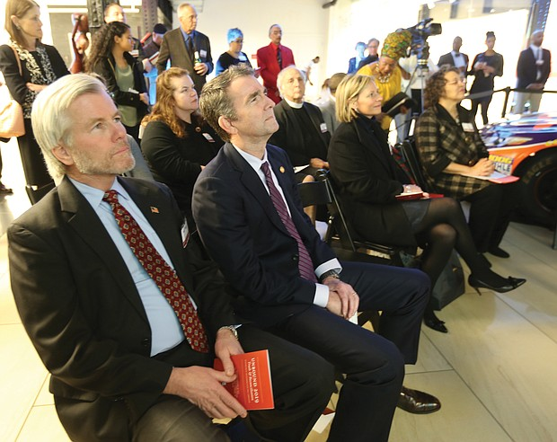 """'Unbound 2019: Truth & Reconciliation': In one of his first public appearances since the blackface scandal, Gov. Ralph S. Northam, second from left, and former Gov. Bob McDonnell, left, attend the opening of """"Unbound 2019: Truth & Reconciliation"""" on Feb. 28, at The Gallery at Main Street Station. This is the first part of a yearlong exhibition launched by the Richmond Slave Trail Commission to tell the stories of Africans in the Americas before 1619 through the present day. Located on the first floor, the exhibition is open to the public without charge 8 a.m. to 5 p.m. daily at the station, 1500 E. Main St. Under Gov. McDonnell's administration, the state put up $11 million for various historical projects related to memorializing the enslaved in Virginia, including the Lumpkin's Jail site and a related museum in Shockoe Bottom and funds for the improvement of the Richmond Slave Trail. (Regina H. Boone/Richmond Free Press)"""