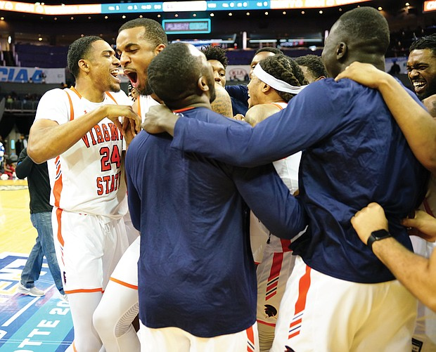 Virginia State University team members celebrate after winning the CIAA title last Saturday in Charlotte, N.C. The Trojans defeated Shaw University 77-66 in the final.