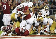 Portland's Cameron Scarlett, a running back at Stanford University in California, drives into the end zone for a touchdown against Notre Dame in this Nov. 25, 2017 photo from AP.