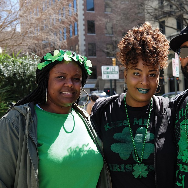 Wearing of the green: From left, Erica Garnett and her sister-in-law and brother, Dashana and Earl Garnett, are decked out in green and shamrocks to celebrate St. Patrick's Day during festivities last Saturday. Parties and special menus were featured at restaurants throughout the area, particularly on Sunday, March 17, which was St. Patrick's Day. The trio was at 5th and Franklin streets in Downtown. (Sandra Sellars/Richmond Free Press)