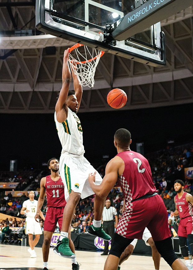 Norfolk State University forward Alex Long goes up for a dunk during the final at the Norfolk Scope.