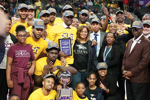 The North Carolina Central University Eagles show off their MEAC Tournament trophy after defeating Norfolk State University 50-47 last Saturday.