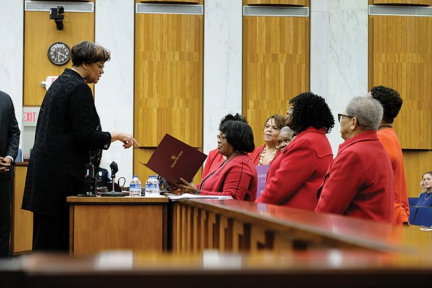 City Councilwoman Ellen F. Robertson, 6th District, left, presents President Connie Cuffee and members of Delta Sigma Theta Sorority's Richmond Alumnae Chapter with a certificate of recognition honoring Ms. Height at Monday night's City Council meeting.