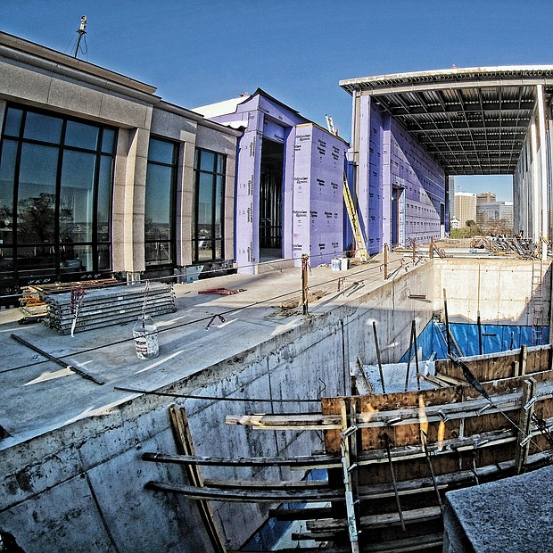 This $28 million addition to the Virginia War Memorial is just months away from completion. Begun in the summer of 2017, the two-year development will expand the shrine to recognize Virginians killed in the Global War on Terrorism, add a gallery to honor Virginians who have received the Medal of Honor, provide more exhibit space, create a 350-seat lecture hall and a studio for recording oral histories and provide 170 parking spaces underground. Public money and private donations are funding the project that will double the size of the nearly 70-year-old memorial at 621 S. Belvidere St. (Sandra Sellars/Richmond Free Press)