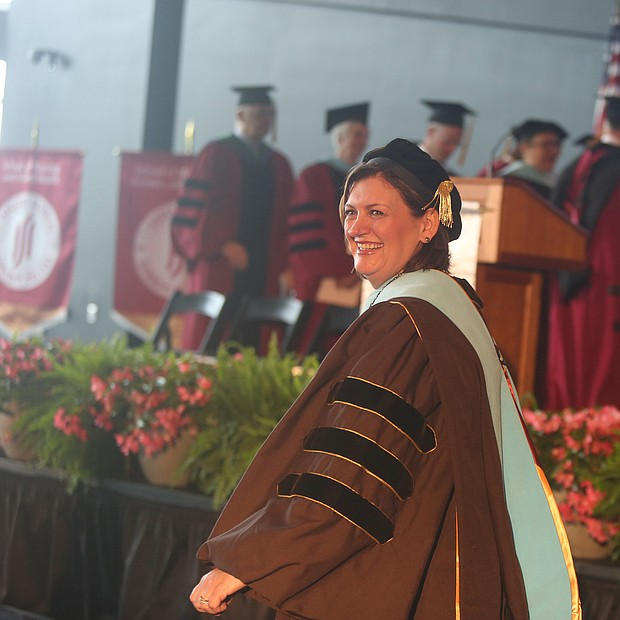 "Reynolds inaugurates new president: Dr. Paula P. Pando is all smiles after her inauguration last Friday as J. Sargeant Reynolds Community College's fourth president. The ceremony, held at the Dewey Gottwald Center at the Science Museum of Virginia, carried the theme ""Equity Through Action."" Dr. Pando, who immigrated with her family to the United States from Chile when she was young, was the first in her family to earn a college degree. She has worked in higher education for more than 20 years, beginning as director of campus activities and programs at Saint Peter's University in Jersey City, N.J. She later joined Hudson County Community College in Jersey City and rose through the ranks, holding three different vice president positions. She was senior vice president for student and educational services there when she was chosen from among 102 applicants in a national search to lead J. Sargeant Reynolds Community College. The college serves more than 15,000 students annually on campuses in Richmond, Henrico and Goochland.  (Regina H. Boone/Richmond Free Press)"