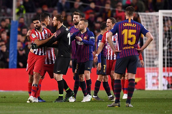 Atletico Madrid striker Diego Costa has been banned for eight games after being found guilty of abusing referee Jesus Gil ...