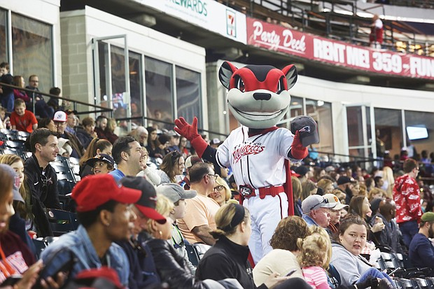 The Richmond Flying Squirrels mascot, Nutzy, works the crowd during last Saturday's doubleheader at The Diamond. The Flying Squirrels opened the season last Thursday with a sold out crowd of 9,845 fans. Last Friday's game was canceled because of the weather, resulting in the doubleheader on Saturday.