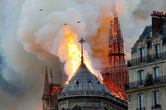 As flames ripped through the roof and into the spire of the Cathedral of Notre Dame on Monday night, French ...