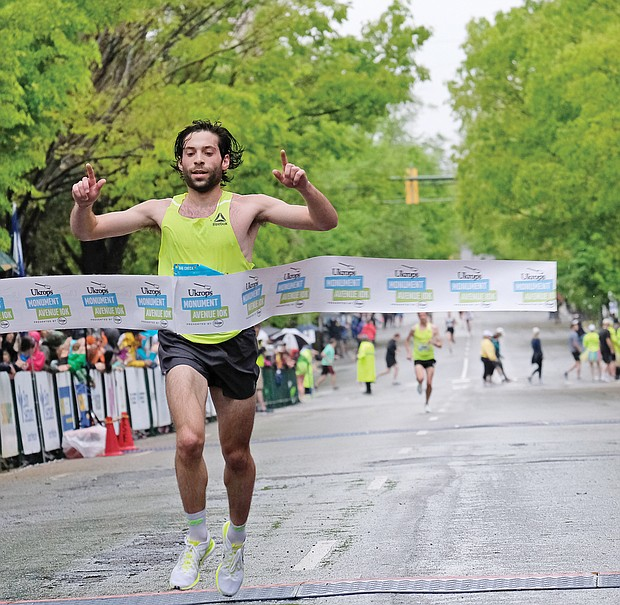 More than 25,000 runners and walkers turned out last Saturday for the annual Monument Avenue 10K. Philo Germano, 23, of Charlottesville is the first to cross the finish line in the main 10K race in 29 minutes, 34 seconds, while, Bethany Sachtleben, 27, of Fairfax wins the women's race in 32:39. Both won $2,000 for first place finishes. (Sandra Sellars/Richmond Free Press)