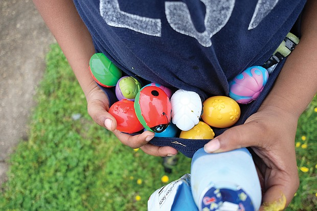 Egg-citing! Marcus Ellis, shows off the colorful collection of eggs he found last Saturday at the 7th Annual Easter Egg Hunt & Celebration at Blackwell Community Center in South Side. The free event was sponsored by Putting Communities Together Inc. (Sandra Sellars/Richmond Free Press)