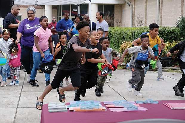 Egg-citing! Youngsters take off to find the hidden eggs last Saturday at the 7th Annual Easter Egg Hunt & Celebration at Blackwell Community Center in South Side. The free event was sponsored by Putting Communities Together Inc. and featured prizes, music, food and a visit by the Easter Bunny. (Sandra Sellars/Richmond Free Press)