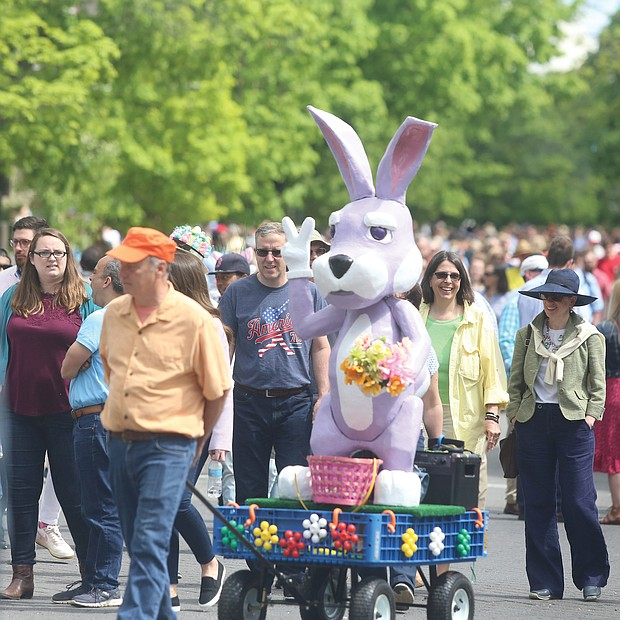 Thousands of people, including the Easter Bunny, stroll along Monument Avenue for what may be the final edition of Easter on Parade.