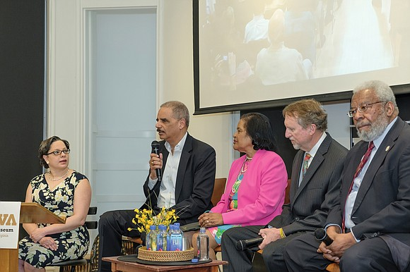 Former U.S. Attorney General Eric H. Holder, second from left, speaks during a civil rights panel discussion last Saturday honoring ...
