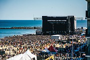Thousands of people enjoy the entertainment on the main stage on the oceanfront at 5th Street in Virginia Beach. Tickets for the three-day festival ranged from $150 to $450. Organizers said they would refund 33 percent of the base price to purchasers after Friday's scheduled concert was canceled because of stormy weather.