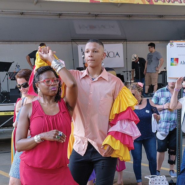 ¿Que Pasa? Festival: The food, music and art of Virginia's Latino communities were in the spotlight last Saturday at the 2019 ¿Que Pasa? Festival, sponsored by the Hispanic Chamber of Commerce along the Riverfront Canal Walk in Shockoe Slip. Right, couples dance to the rhythms of Latin music, while festivalgoers, below, line up for boat rides along the canal in vessels decorated like the boats in Xochimilco, Mexico.