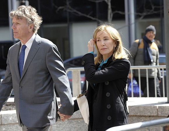 Felicity Huffman broke down crying before a federal judge Monday after she pleaded guilty to paying $15,000 to a fake ...