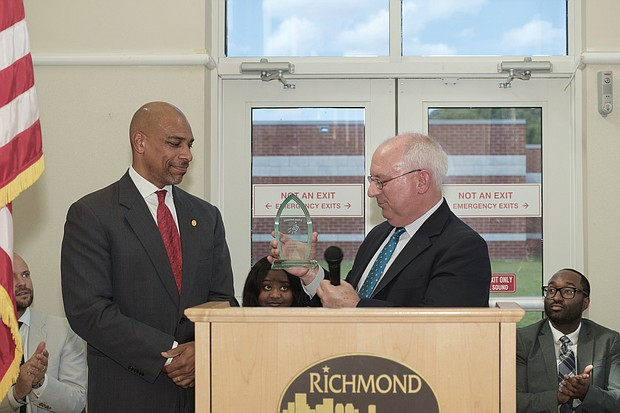 """Oliver Hill Day/Lamont K. Barnes, left, program coordinator with the Richmond Department of Justice Services, receives the Unsung Hero Award from attorney James M. Nachman during the 22nd Annual Oliver Hill Day on May 10 at the Oliver Hill Courts Building. The theme: """"Free Speech, Free Press, Free Society."""" The event honors the memory of Mr. Hill, a lawyer and civil rights icon whose successful legal battles against racial discrimination helped end the unconstitutional doctrine of """"separate but equal."""" (Regina H. Boone/Richmond Free Press)"""