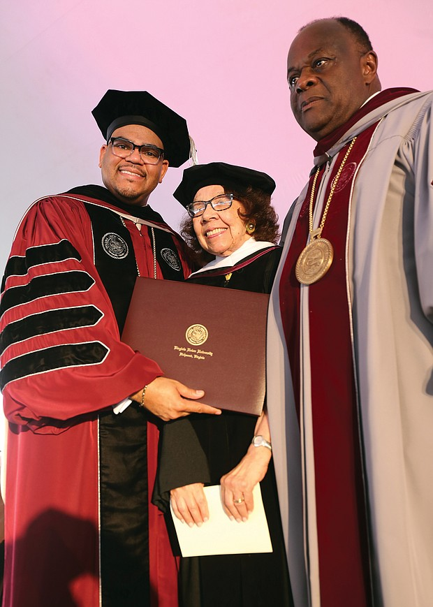 Barbara Radcliffe Grey, a VUU alumna and longtime director of the VUU Museum Art Galleries, is presented with an honorary degree from VUU President Hakim J. Lucas, left, and Dr. W. Franklyn Richardson, chairman of the VUU Board of Trustees.